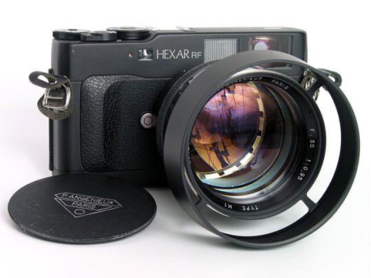 Angenieux 50/0.95 Type M1 converted to Leica M mount: Original lens does not contain aperture, was inserted, helicoid added, custom hood to prevent viewfinder blockage