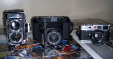 Fujifilm GF670 Professional next to a Rolleiflex and Leica M6